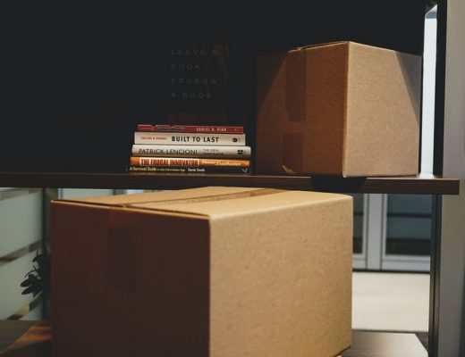 packing boxes with bookshelf